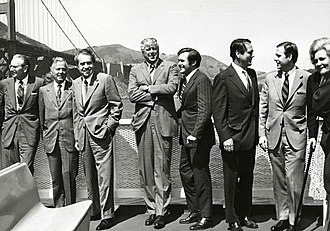 Pete Wilson - Mayor Wilson (second from right) with U.S. President Richard Nixon, First Lady Pat Nixon, and others including Interior Secretary Rogers C.B. Morton and Counselor to the President Donald Rumsfeld in front of the Golden Gate Bridge, September 1972