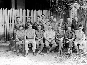 No. 61 Wing headquarters personnel at Darwin in June 1944. The commanding officer, Wing Commander D.J. Rooney, is in the centre of the front row.