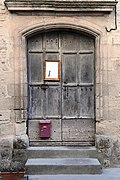 Old door with notepad and pen attached.jpg