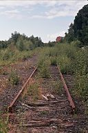 https://upload.wikimedia.org/wikipedia/commons/thumb/3/33/Old_rails_in_Toppila_Aug2011_001.jpg/128px-Old_rails_in_Toppila_Aug2011_001.jpg
