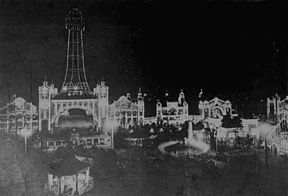 Nighttime picture of Osaka Luna Park, also known as Shinsekai Luna Park, ca. 1912. An aerial tramway connected the amusement park with the original Tsutenaku Tower. The park closed in 1923; the tower was damaged in a fire and dismantled 20 years afterward.