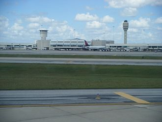 Orlando International Airport - View of a terminal as seen from an arriving plane with the control tower in the background