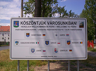 Pápa - Sign showing twin towns of Pápa. The centre-right town is Covasna in Romania and the bottom-left is Lučenec in Slovakia, these are presented in their historical Hungarian names, all others are consistent with local forms.