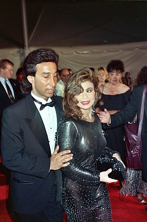 1990s in fashion - Actress Paula Abdul wearing semi-transparent black dress, curled hair and smoky eye makeup, 1990.
