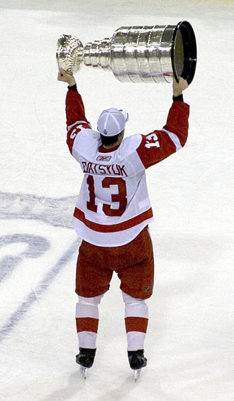 Stanley Cup - After winning the Cup, players traditionally skate around holding the trophy above their heads, as Pavel Datsyuk of the Detroit Red Wings does here when the Red Wings captured their 11th cup in 2008