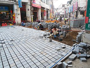 Roadworks - Replacing the old road with cobblestones of cement in Bo'ao Road area, Haikou City, Hainan, China