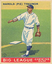 A baseball card showing a man in a white baseball uniform throwing a ball.