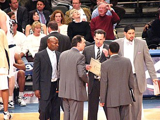 Pittsburgh Panthers men's basketball - Head coach Jamie Dixon (clipboard) huddles with his coaching staff in 2007