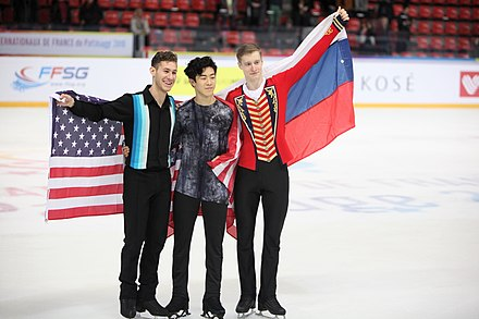 The three men medallists with their flags