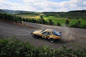 Rallye Deutschland - A historic Porsche 924 GTS driven through a stage during the 2008 rally.