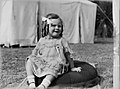 Portrait of a toddler girl seated on the grass (AM 85182-1).jpg