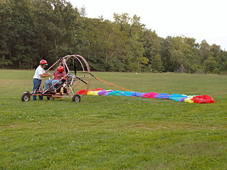 Powered parachute - A powered parachute with its wing laid out in preparation for takeoff.