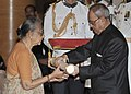 Pranab Mukherjee presenting the Padma Shri Award to Smt. Uma Vasudevan, wife of Shri Rangarajan Vasudevan (Posthumous), at a Civil Investiture Ceremony, at Rashtrapati Bhavan, in New Delhi on April 08, 2015.jpg