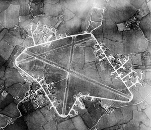 RAF Ridgewell - Aerial photograph of RAF Ridgewell, the bomb dump is to the right of the airfield as at 29 February 1944.  Many B-17 Flying Fortresses of the 381st Bombardment Group are visible in the photo, parked on hardstands around the perimeter track.