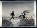 RG208-AA-159-D-1-China-Action-Peasant women leaving field during air raid.tiff