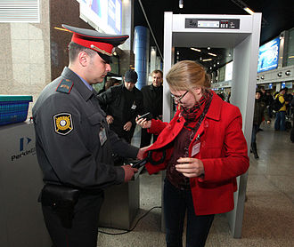 Law enforcement in Russia - A law enforcement officer screens a passenger at the international airport of Vladivostok.