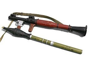 Rocket-propelled grenade - A rocket-propelled grenade (on the left) and RPG-7 launcher. For use, the thinner cylinder part of the rocket-propelled grenade is inserted into the muzzle of the launcher.