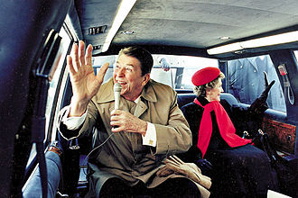 1984 United States presidential election in Illinois - On the campaign trail, President Reagan and First Lady Nancy Reagan wave from limousine while touring Dixon, Illinois. February, 1984.