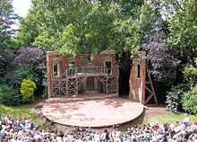 open air stage, with trees seen behind the setting