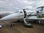 Revesco Aviation (VH-PNM) Embraer Phenom 100 on display at the 2015 Australian International Airshow.jpg