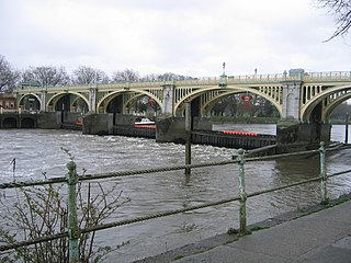 lock and pedestrian bridge, situated on the River Thames in south west London