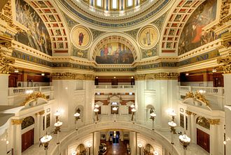 Pennsylvania State Capitol - The interior of the capitol rotunda. Two medallions and three lunettes are visible, from left to right: Spirit of Light, Law, Science Revealing the Treasures of the Earth, Religion and Spirit of Vulcan. Portions of William Penn's quote are also visible.