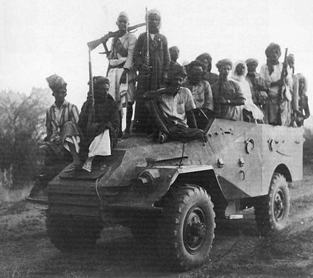 A Soviet-manufactured armored car, captured by royalist guerrillas from the Egyptians near Haradh Royalists on armored car.jpg