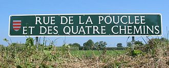 Saint Martin, Jersey - The dolmen (in Jèrriais, pouquelaye or archaically pouclée) at Faldouet gives rise to the longest road name in Jersey: Rue de la Pouclée et des Quatre Chemins