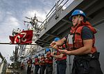 Sailors extend a phone and distance line to USNS John Ericsson during a replenishment-at-sea. (30162871312).jpg