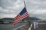 Sailors raise the ensign during morning colors. (37031744711).jpg