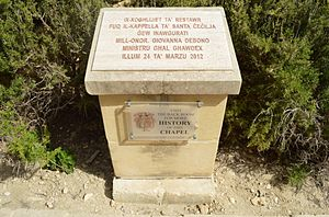 Santa Cecilia Chapel - Plinth with a plaque commemorating the inauguration of the restored chapel in 2012