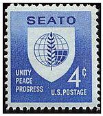 Bildo de usona poŝtmarko portanta la SEATO-emblemon