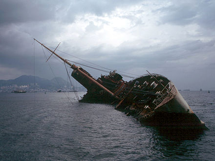 The ocean liner RMS Queen Elizabeth caught fire and capsized in Victoria Harbour in 1972. Seawise University wreck.jpg