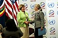 Secretary Clinton Shakes Hands With OPIC President and CEO Littlefield (7449876898).jpg