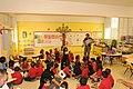 September 29, 2011 Education efforts at Las Mareas Elementary School in preparation to receive Tuque, the manatee as a new member of this community. Dr. Antonio Mignucci dedicating the book, Manatí de Puerto Rico. (6218114458).jpg