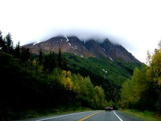 Seward Highway - Seward Highway, in the Chugach National Forest, approaching a snow-capped mountain range