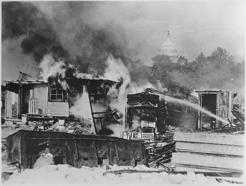 Shacks, put up by the Bonus Army on the Anacostia flats, Washington, DC, burning after the battle with the military, 193 - NARA - 531102
