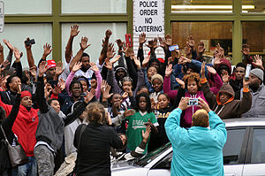 Hands up, don't shoot - Group of people in Shaw, St. Louis with their hands raised in October 2014