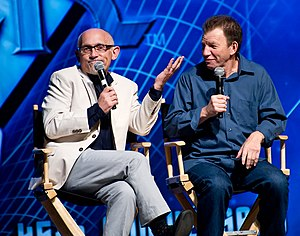 Armin Shimerman - Shimerman (left) and Max Grodénchik (right) played the characters of two Ferengi brothers, Quark and Rom, on Deep Space 9
