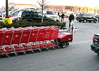 Nested Carts Being Returned From A Parking Lot To Target Store By Cart Pushing Assist Device