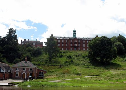 Shrewsbury School viewed from The Quarry, with the school's boathouse in the foreground.