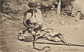 Snake charmer, in costume and playing to Cobra.jpg