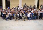 Soldiers distribute new school supplies to Sadr City children DVIDS151128.jpg