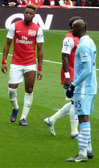 Mario Balotelli - Balotelli (right) with Alex Song and Bacary Sagna in April 2012.
