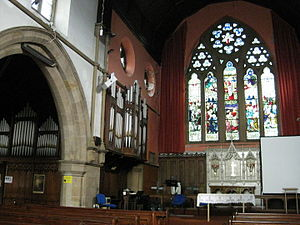 Burmantofts - St Agnes' interior, showing organ, altar with reredos in Burmantofts faience and stained glass East window.
