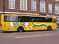 St Andrews Street, Norwich - Yellow bus - Working together ... making it happen.jpg