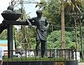 Statue of a farmer at Athani Junction.JPG