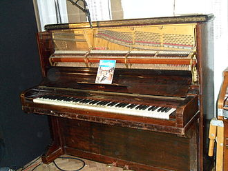 "Tack piano - An aged upright piano—specifically the 1905 ""Mrs. Mills"" Steinway Vertegrand owned by Abbey Road Studios"