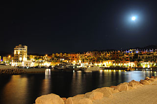 Tala Bay Marina by Night (6150670511).jpg