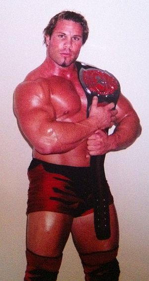 Tank Toland - Toland in 2003 holding an OVW Southern Tag Team Championship title belt.